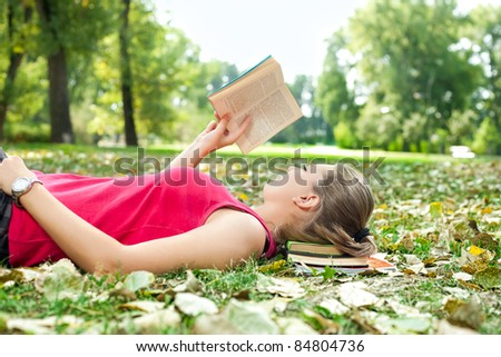 young woman relaxing and reading book - stock photo