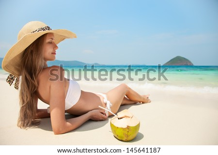Young Woman Relaxing At Tropical Beach - stock photo