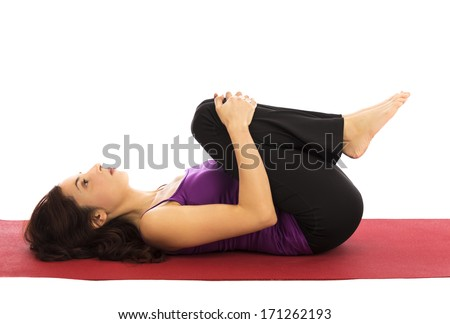 Young woman relaxing during yoga (Series with the same model available) - stock photo