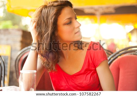 young woman relaxing in cafe summer day - stock photo