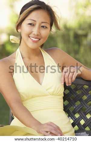 Young Woman Relaxing In Garden - stock photo