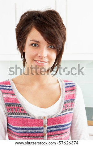 Young Woman Relaxing In Modern Kitchen - stock photo