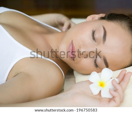 young woman relaxing in spa salon - stock photo