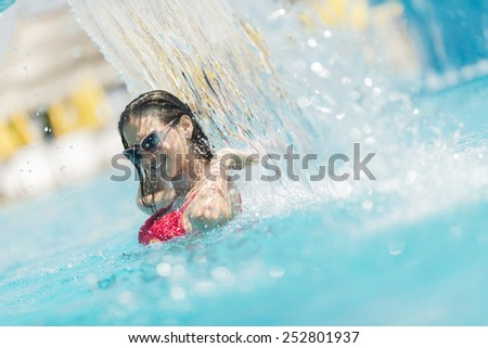 Young woman relaxing in the pool - stock photo