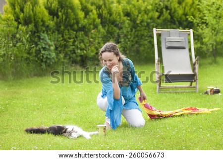 Young woman relaxing on nature - stock photo