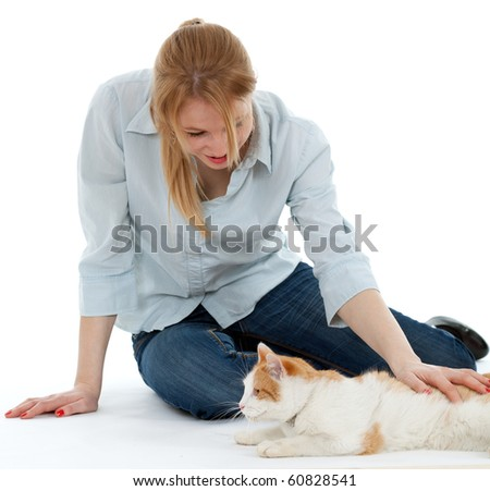 young woman relaxing with her lovely cat - stock photo