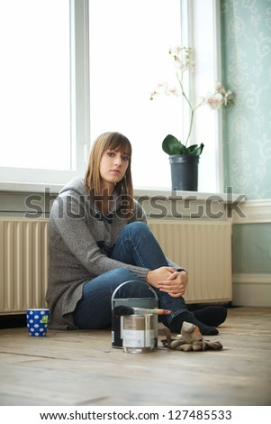Young woman renovating and relaxing at home - stock photo