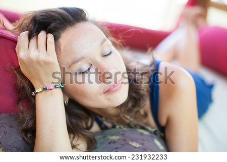 Young woman resting. Charming woman in a restaurant. Beautiful woman at cafe restaurant lifestyle portrait, summer vacation of sexy young girl. - stock photo