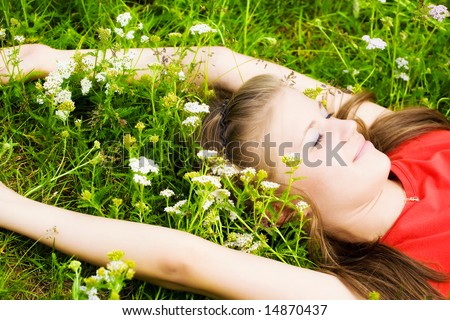Young woman resting in grass. - stock photo