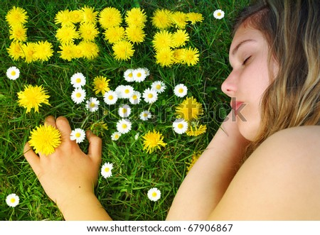 Young woman resting on the meadow - stock photo