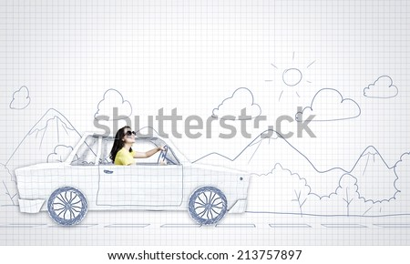 Young woman riding car made of list of paper - stock photo