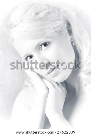 Young woman romantic portrait. High-key style. - stock photo