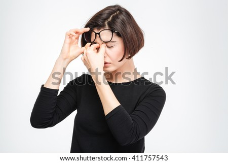 Young woman rubbing her eyes isolated on a white background - stock photo