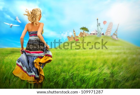 Young woman running to world's famous buildings across he field. Traveling loan concept - stock photo