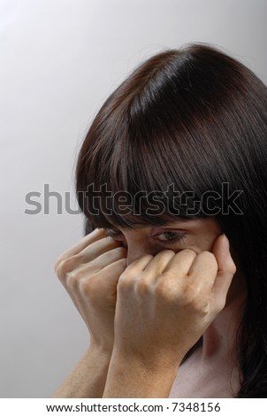 Young woman's cry. Studio portrait. She is afraid - stock photo