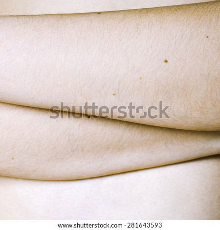 Young woman's hands on a belly background - stock photo
