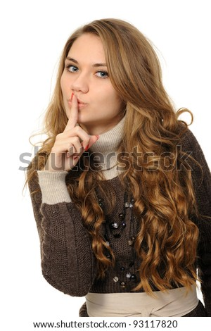 Young woman says ssshhh to maintain silence on a white background - stock photo