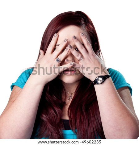 Young woman, scared and hiding - stock photo