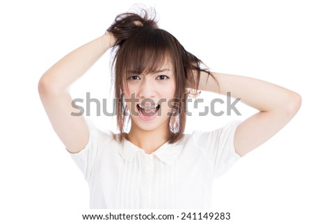 young woman scratching her hair isolated on white background - stock photo