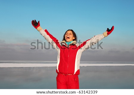 Young woman scream into cold winter sky - stock photo