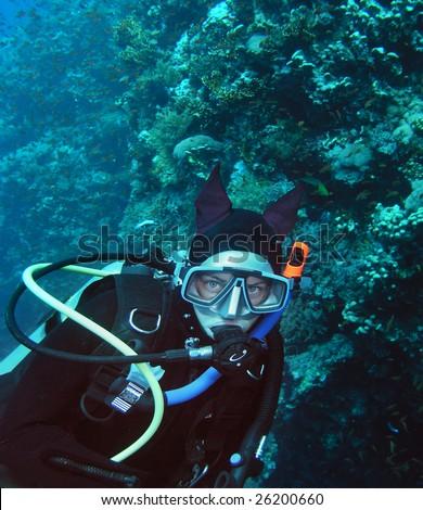 Young woman scuba diver - stock photo