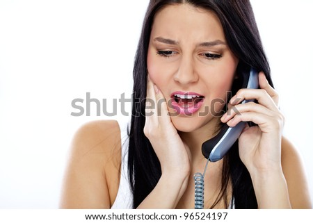 Young woman searching  help for  toothache - stock photo