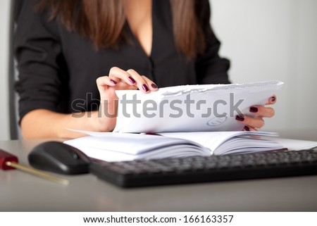 young woman secretary sort by size letters - stock photo