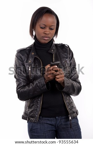 Young woman sending a text message from her cell phone. - stock photo