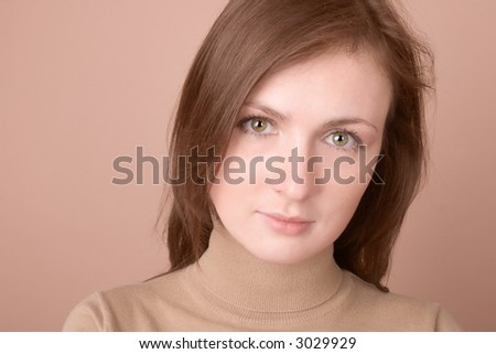 Young woman serious look - portrait isolated on white - stock photo