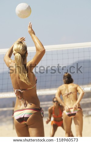 Young Woman Serving Volleyball - stock photo