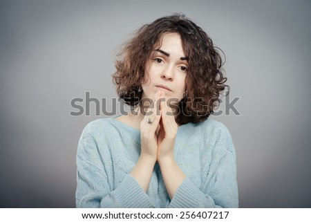 Young woman shocked. Attractive female student in a sweater - stock photo