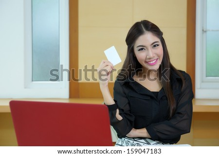 Young woman shopping on the Internet with credit card.  - stock photo