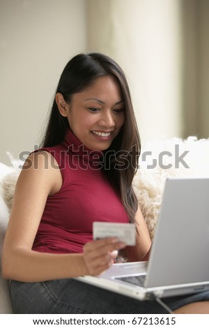 Young woman shopping on the Internet with credit card - stock photo