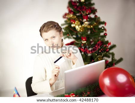 Young woman shopping online - stock photo