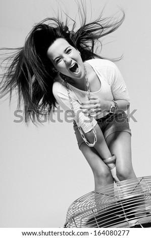 Young woman shouting having fun - stock photo