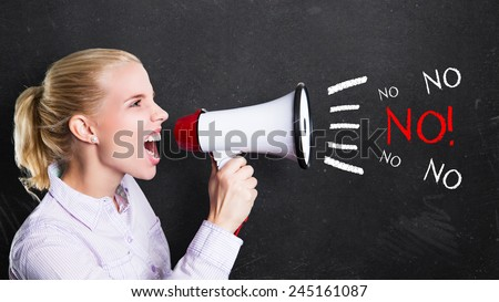 young woman shouting No! through a megaphone - stock photo
