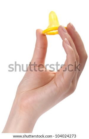 young woman showing condom in hand - stock photo