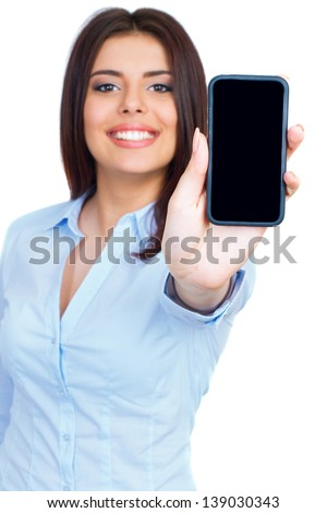 Young woman showing display of mobile cell phone with black screen and smiling on a white background. Focus on hand. - stock photo