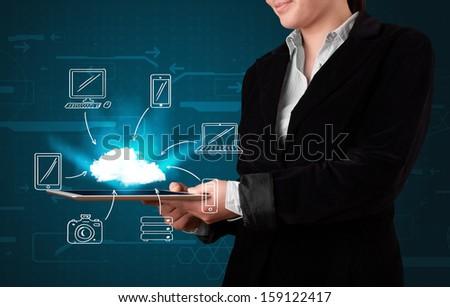 Young woman showing hand drawn cloud computing - stock photo