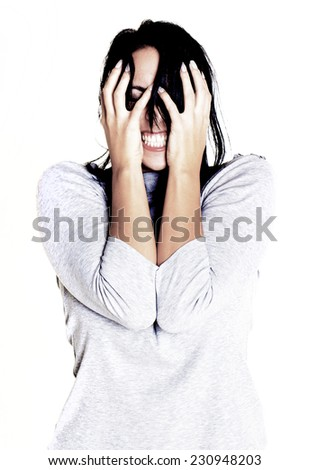 Young woman showing her anger and stress towards someone over a white background. - stock photo