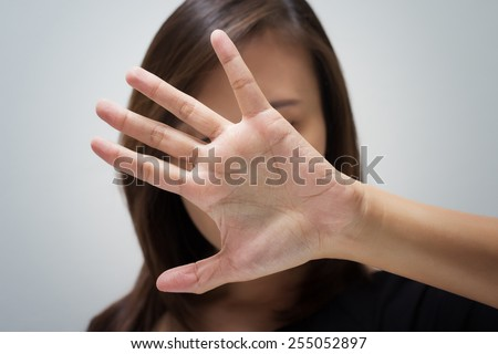 Young woman showing her denial with NO on her hand - stock photo