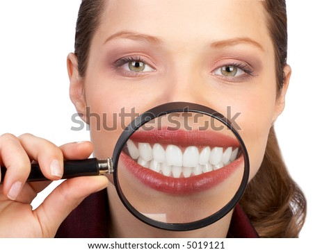 Young woman showing her healthy teeth. Isolated over white background - stock photo