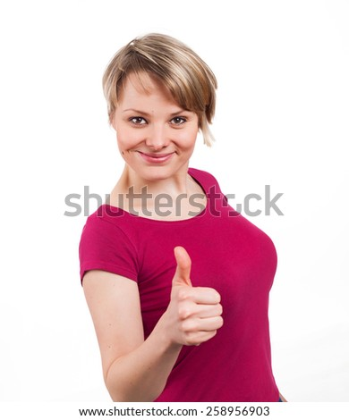 Young woman showing her thumb up and looking very confident, isolated on white - stock photo