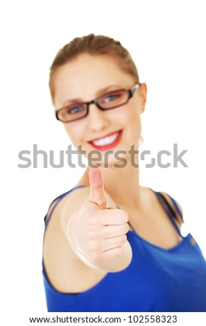 Young woman showing OK. Looking at camera and smiling. - stock photo