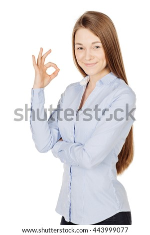 young woman showing ok sign. emotion expression and lifestyle concept. image on a white studio background. - stock photo
