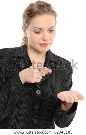 Young woman showing on something by a finger - isolated on a white background - stock photo