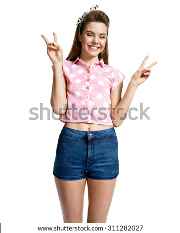 Young woman showing peace sign / photo of young cheerful brunette woman over white background, positive emotions - stock photo