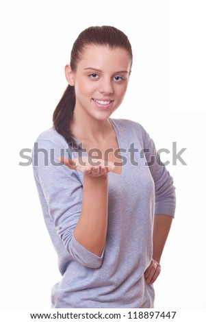 young woman showing something on palm before her - stock photo