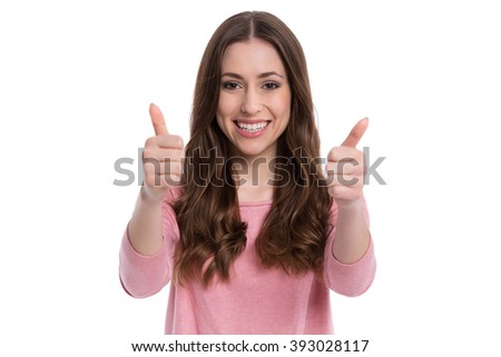 Young woman showing thumbs up  - stock photo