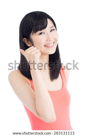 young woman showing thumbs up gesture isolated on white background - stock photo